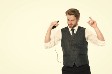 Businessman in headset with cell phone.