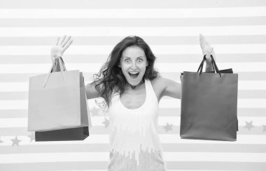 Feel free buy everything you want. Woman carries bunch shopping bags striped background. Finally bought favorite brand. Tips shop sales. Girl satisfied with shopping. Profitable purchase black friday