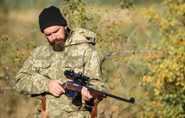 Bearded man hunter. Military uniform. Army forces. Camouflage. Hunting skills and weapon equipment. How turn hunting into hobby. Man hunter with rifle gun. Boot camp. Guy hunting nature environment