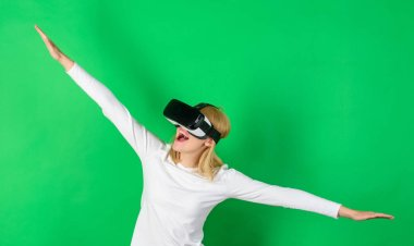 Woman excited using 3d goggles. Woman wearing virtual reality goggles. Woman with virtual reality headset. Game VR.