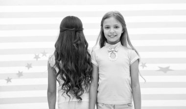 hair wave or perm. hair wave or perm for brunette and blonde small girl. small girl kids at hairdresser. time stops when you looking at them
