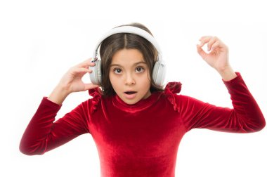 Little girl listen music wireless headphones. Online music channel. Girl little child use music modern headphones. Listen for free new and upcoming popular songs right now. Music always with me