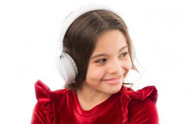 Girl little child use music modern headphones. Listen for free new and upcoming popular songs right now. Music always with me. Little girl listen music wireless headphones. Online music channel
