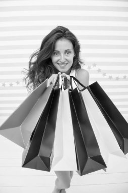 Woman carries bunch shopping bags striped background. Finally bought favorite brand. Tips shop sales. Girl satisfied with shopping. Profitable purchase black friday. Feel free buy everything you want