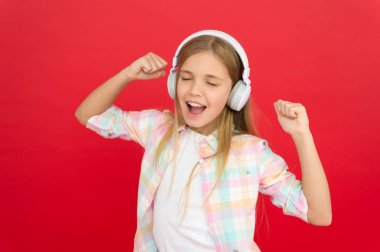 Childhood happiness. Mp3 player. small kid listen ebook, education. childrens day. Audio technology. small girl child in headphones. Listen to music. Beauty fashion. Enjoying the rhythm of her life