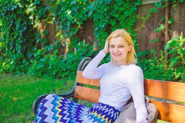 Time for yourself. Woman blonde take break relaxing in park. Girl sit bench relaxing in shadow, green nature background. Why you deserve break. Ways to give yourself break and enjoy leisure