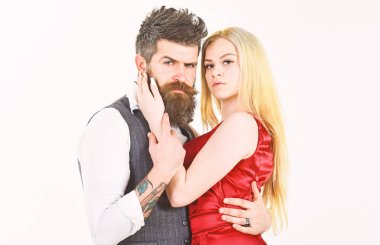 Woman in red dress and man in vest. Dancing couple concept. Bearded hipster and attractive lady dressed up for dancing contest. Couple in love, passionate dancers in elegant clothes, white background