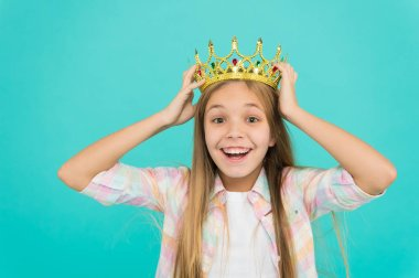 Girl wear crown blue background. Cute emotional sincere princess. Kid wear golden crown symbol princess. Every girl dreaming become princess. It is such great honor for me. Title miss little princess