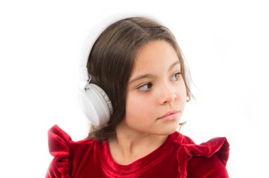 Music is so much fun. small girl in red dress. childhood and happiness. small child in headphones. music. listening ebook. audio education. kid fashion and beauty. happy childrens day