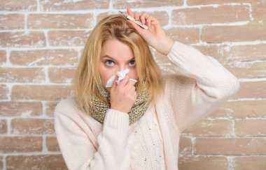 Measure temperature. Break fever remedies. High temperature concept. Woman feels badly ill. How to bring fever down. Fever symptoms and causes. Sick girl with fever. Girl hold thermometer and tissue