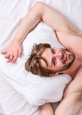 Get adequate and consistent amount of sleep every night. How much sleep you actually need. Bearded man sleeping face relaxing on pillow. Man handsome guy lay in bed. Expert tips on sleeping better