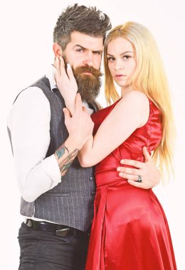 Couple in love, passionate dancers in elegant clothes, white background. Woman in red dress and man in vest. Dancing couple concept. Bearded hipster and attractive lady dressed up for dancing contest
