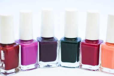 Manicure salon. Gel polish modern technology. Fashion trend. Nail polish bottles. Beauty and care concept. Durability and quality polish coating. Nail polish white background. How to combine colors