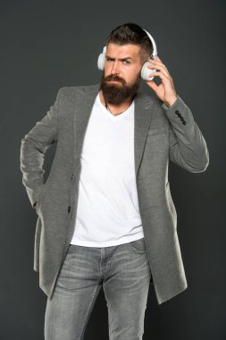 brutal caucasian hipster with moustache. Man in headphones. Audio book education. Mp3. modern life technology. Mature hipster with beard. Bearded man listen to music. Confident and handsome