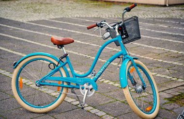 Reykjavik, Iceland - October 12, 2017: blue bicycle with basket. Bike on parking. Transport and transportation. Travel adventure and discovery. stock vector