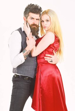 Bearded hipster and attractive lady dressed up for dancing contest. Couple in love, passionate dancers in elegant clothes, white background. Woman in red dress and man in vest. Dancing couple concept