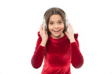 Time to relax. small child in headphones. music. listening ebook. audio education. happy childrens day. childhood and happiness. kid fashion and beauty. small girl in red dress