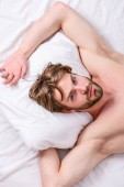 Bearded man sleeping face relaxing on pillow. Man handsome guy lay in bed. Get adequate and consistent amount of sleep every night. Expert tips on sleeping better. How much sleep you actually need