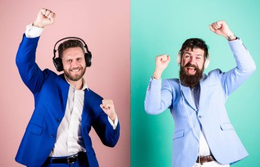 Colleagues listen to music. Music and relax. Men bearded faces formal suit enjoy song. Playlist for office work. Music break during working day. Business people with headphones listening music