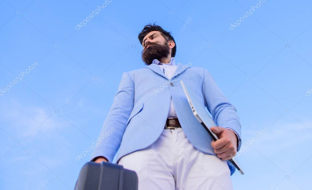 Illegal deal business. Hipster bearded face hold briefcase with bribe. Businessman presenting business case. Business man formal suit carries briefcase sky background. Entrepreneur offer bribe