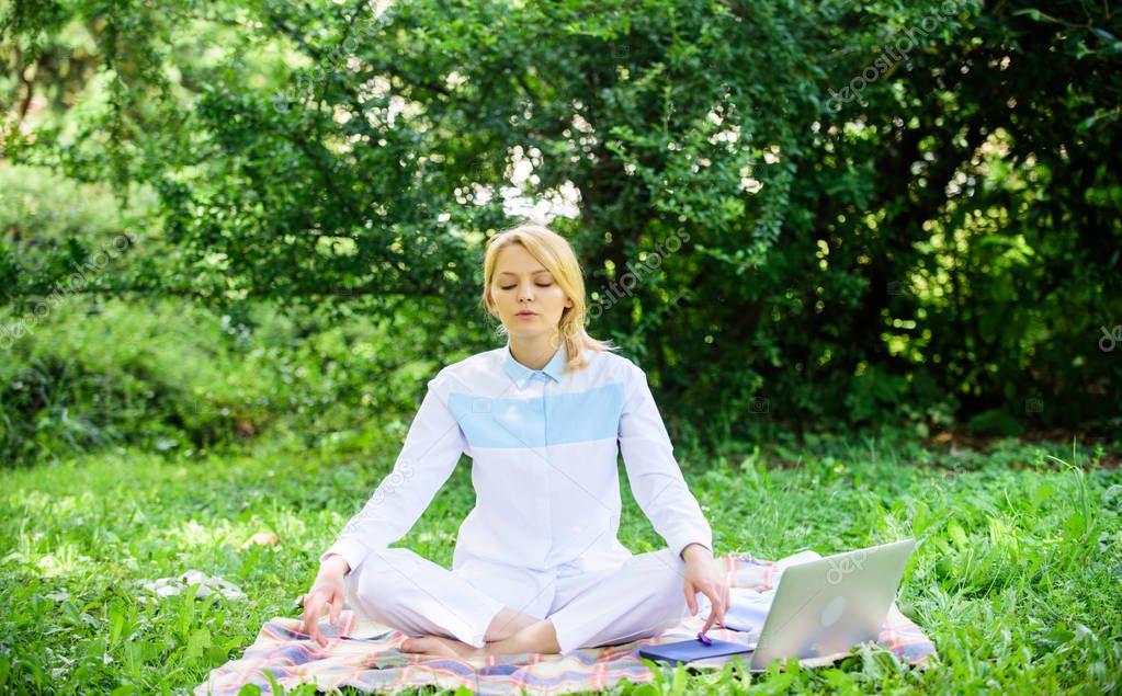 Woman relaxing practicing meditation. Reasons you should meditate every day. Find minute to relax. Clear your mind. Girl meditate on rug green grass meadow nature background. Every day meditation