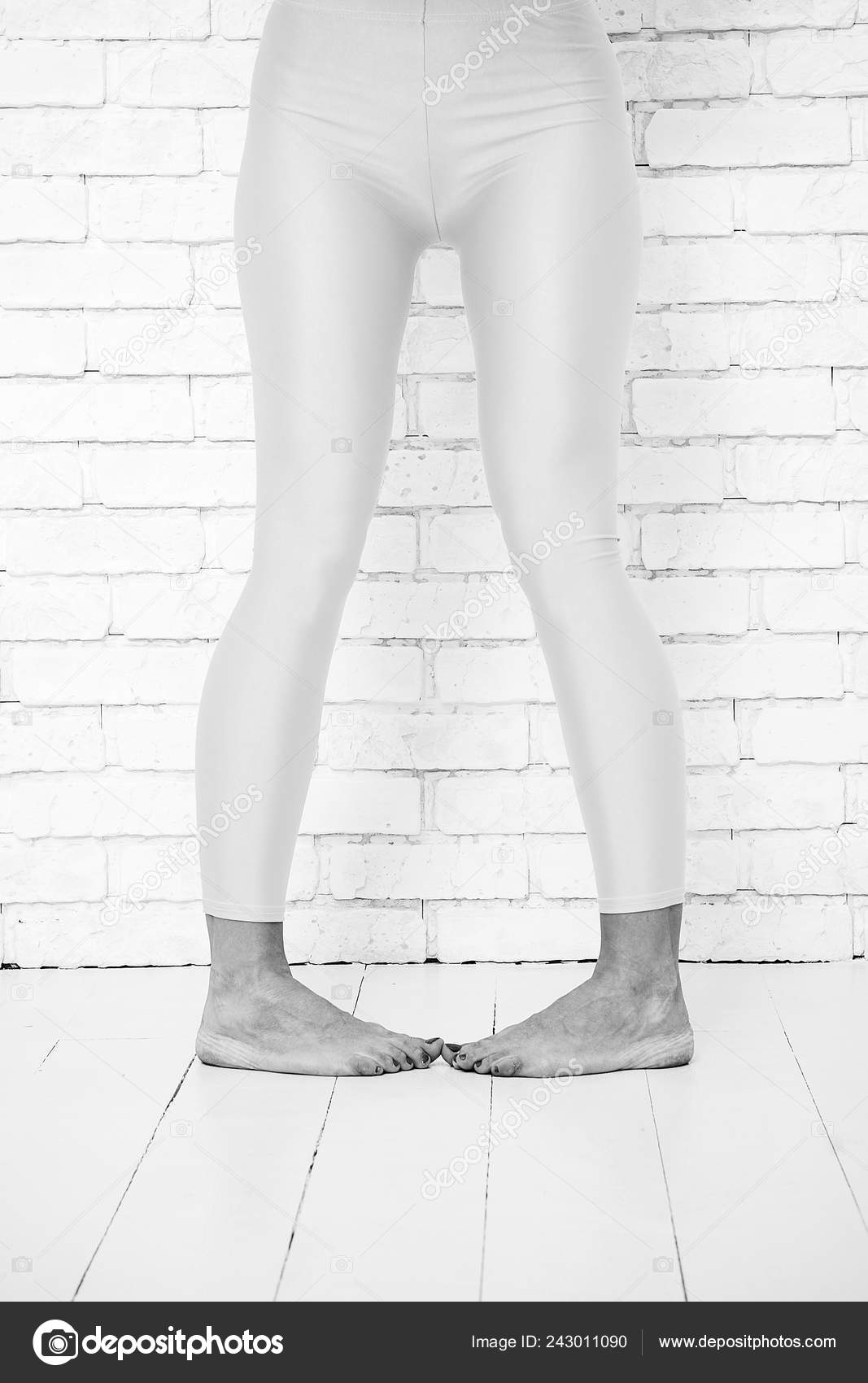 dedd9dbc5 playful girl in crazy dancing ballet position of feet. woman in orange  leggings on legs. Dance to rhythm of your heart. orange. practicing in  ballet studio. ...