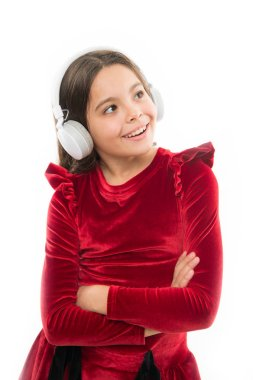 Online music channel. Girl little child use music modern headphones. Music always with me. Listen for free new and upcoming popular songs right now. Little girl listen music wireless headphones