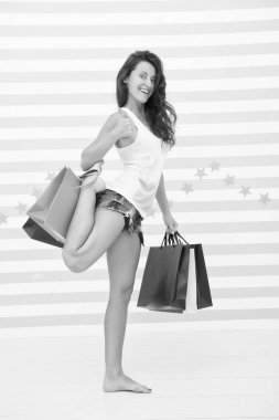 Too many packages to hold by only hand. Woman carries bunch shopping bags striped background. Finally bought favorite brand. Tips shop sales. Girl satisfied shopping. Profitable purchase black friday