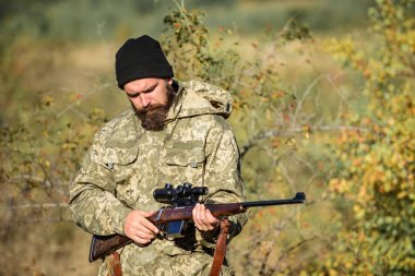 Bearded man hunter. Military uniform fashion. Army forces. Camouflage. Hunting skills and weapon equipment. How turn hunting into hobby. Man hunter with rifle gun. Boot camp. he is a business shark
