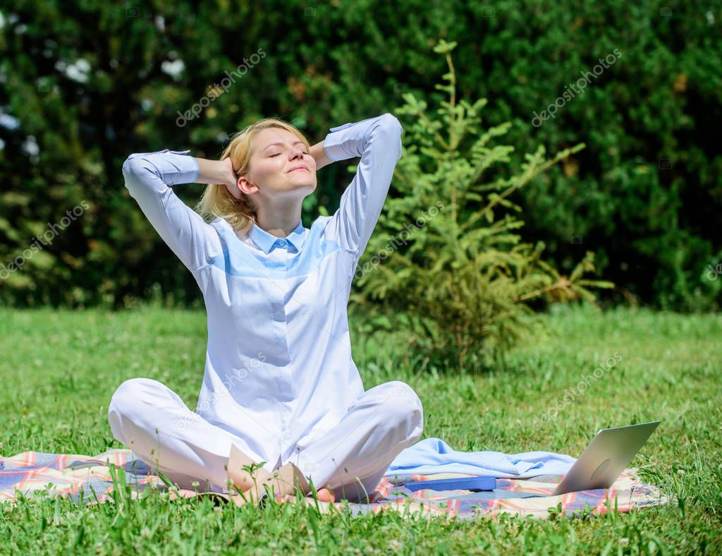 Girl meditate on rug green grass meadow nature background. Woman relaxing practicing meditation. Every day meditation. Reasons you should meditate every day. Clear your mind. Find minute to relax