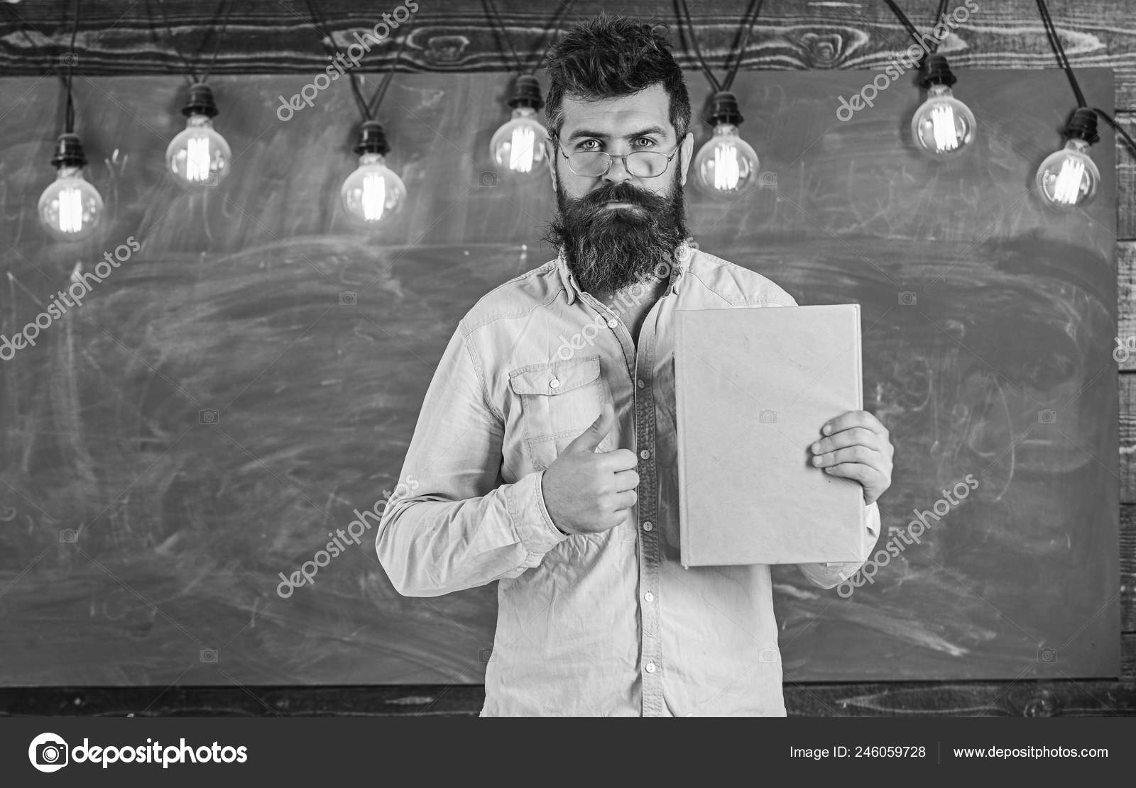 Bearded Hipster Holds Book Chalkboard On Background Teacher In Eyeglasses Recommends Book Thumbs Up Recommendation Concept A daily updated picture and movie tgp of skinny girls only! https depositphotos com 246059728 stock photo bearded hipster holds book chalkboard html