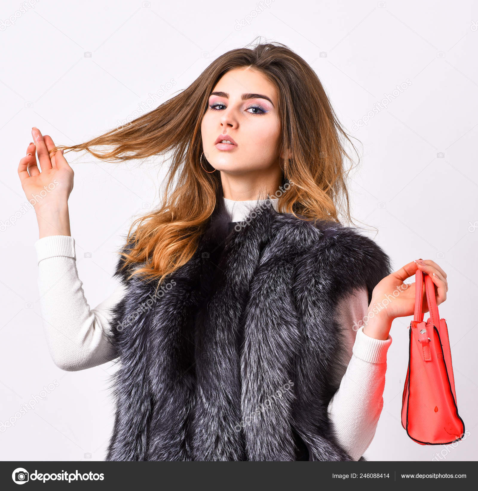 fea4eee0 Female stylish fashion model. Fashion stylish accessory. Fashion and  shopping concept. Woman in fur coat with handbag ...