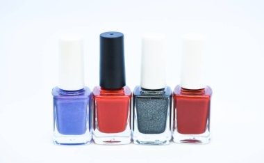 Nail polish white background. Gel polish modern technology. How to combine colors. Manicure salon. Fashion trend. Nail polish bottles. Beauty and care concept. Durability and quality polish coating