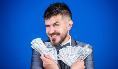 Increasing his cash income. Currency broker with bundle of money. Rich businessman with us dollars banknotes. Bearded man holding cash money. Making money with his own business. Business startup loan