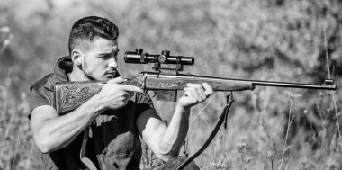 Guy hunting nature environment. Hunting weapon gun or rifle. Hunting target. Looking at target through sniper scope. Man hunter aiming rifle nature background. Hunting skills and weapon equipment