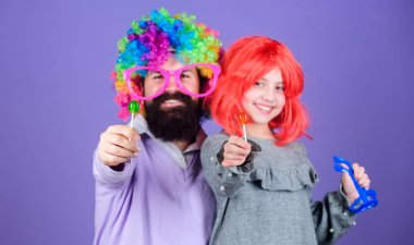 Tribute to fun dad. Easy simple ways be fun playful parent. How crazy is your father. Man bearded father and girl wear colorful wig while eat lollipop candy. Thing loving father do for children