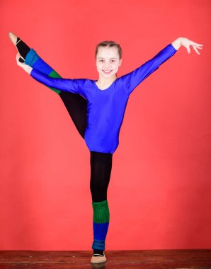 stretching and flexibility. Gymnastics. Happy child sportsman. Sport and health. success. Childhood activity. Fitness diet. Energy. Acrobatics gym workout of teen girl. Having a good stretch