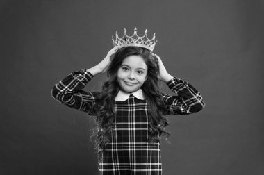 Monarch attribute. Kid wear golden crown symbol of princess. Every girl dreaming to become princess. Lady little princess. Girl wear crown red background. Monarch family concept. Princess manners