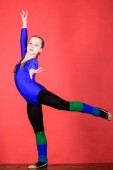 Try hard. Girl little gymnast sports leotard. Physical education and gymnastics. Flexible healthy body. Future star of rhythmic gymnastics. Rhythmic gymnastics sport combines elements ballet dance