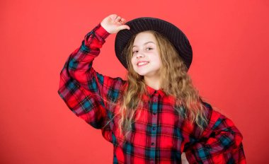 Enter acting academy. Girl artistic kid practicing acting skills with black hat. Acting school for children. Acting lessons guide children through wide variety of genres. Develop talent into career