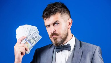 The initial loan. Business startup loan. Bearded man holding cash money. Rich businessman with us dollars banknotes. Currency broker with bundle of money. Making money with his own business