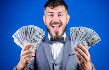 Making money with his own business. Bearded man holding cash money. Rich businessman with us dollars banknotes. Currency broker with bundle of money. Business startup loan. Boosting his income