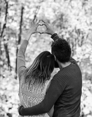 Couple in love show heart sign with fingers