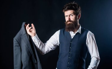 Fashion designer at work. Tailor businessman in suit. brutal caucasian hipster with moustache. Designer tailoring suit. Mature hipster with beard. Male formal fashion. Bearded man gentleman