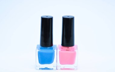 Manicure salon. Fashion trend. Nail polish bottles different colors. Beauty and care concept. Nail polish white background. Durability and quality of nail polish coating. Gel polish modern technology