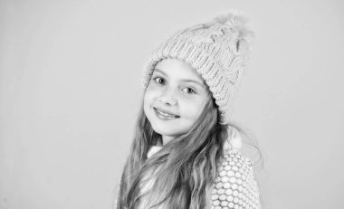 Prevent winter hair damage. Winter hair care tips you should definitely follow. Winter time train yourself to go longer between washes. Child long hair smiling. Girl wear knitted hat pink background