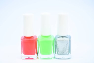 Beauty and care concept. Nail polish white background. Durability and quality polish coating. Gel polish modern technology. How to combine colors. Manicure salon. Fashion trend. Nail polish bottles