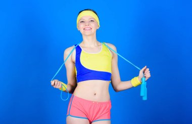 Fit body. Sport skipping rope equipment. Athletic fitness. Happy woman workout with jump rope. Strong muscles and power. Sporty woman training in gym, fit. Health diet. Success. Fit and healthy