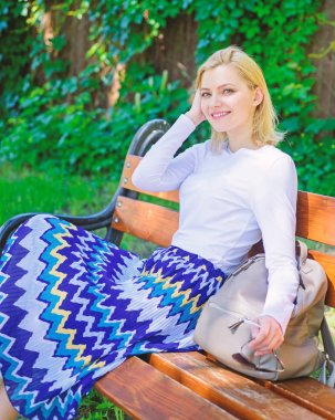 Time for yourself. Why you deserve break. Ways to give yourself break and enjoy leisure. Girl sit bench relaxing in shadow, green nature background. Woman blonde take break relaxing in park