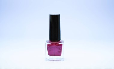 Durability and quality of nail polish coating. Gel polish modern technology. Fashion trend. Nail polish bottle bright color. Manicure salon. Beauty and care concept. Nail polish white background